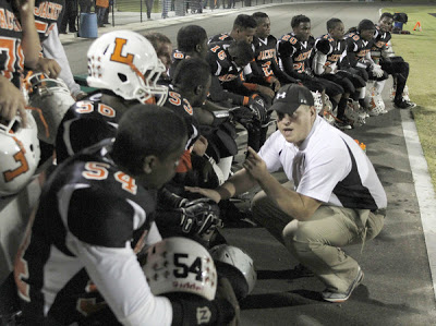 2011 Leesburg Yellow Jackets High School Football Archives, ( Reinhold Matay, Special to the Orlando Sentinel / October 21, 2011 ), Despite having 17 staples in his head, Leesburg offensive coach Damon Eichhorst, bottom right, talks to his offensive line during a high school football game on Friday, October 21, 2011 in Orlando, Fla. Evans beat Leesburg 20-10. Eichorst was airlifted from the crash when he and two other coaches were involved in a serious crash en route to last weeks game against South Sumpter high school. Carver Heights Quarterback Club, Leesburg High School, Leesburg, Florida