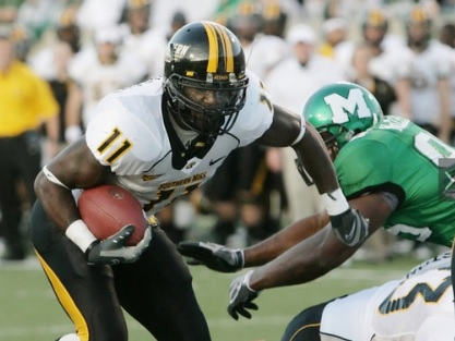 2009 Jackets In College Football Archives, Southern Miss Running Back #11 Tory Harrison (Leesburg High School, Leesburg Florida) left breaks away from Marshall defensive end Albert McClellan during a NCAA college football game on Saturday, November 14, 2009 at Joan C. Edwards in Huntington W. Va.  (AP Photo Randy Snyder), Carver Heights Quarterback Club, Leesburg High School, Leesburg, Florida.