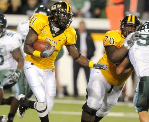 2009 Jackets In College Football Archives, Southern Miss running back Tory Harrison (Leesburg High School, Leesburg, Florida) gains yardage against Tulane (AP photo/The Hattiesburg American Matt Bush), Carver Heights Quarterback Club, Leesburg High School, Leesburg, Florida