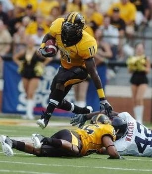 2009 Jackets In College Football Archives, #11 Running Back, Tory Harrison, University of Southern Mississippi, iFormer Jackets standout Tory Harrison leaps over a defender during the Golden Eagles win over Virgina (AP), Carver Heights Quarterback Club, Leesburg High School, Leesburg, Florida.