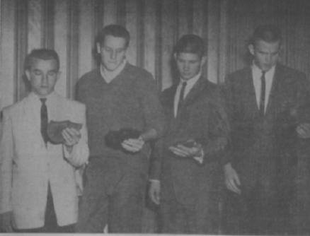 PLAYERS PRESENTED AWARDS-Jimmy Bates, Bill McBride, David Herlong and Max Wettstein are looking at the plaques they were presented at a Football banquet sponsored by the Florida Telephone Corp. Herlong was awarded as the best all-around back, Wettstein, best all-around lineman and Bates and McBride, the linemen showing the most improvement.