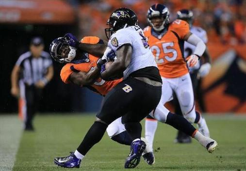 DENVER, CO - SEPTEMBER 5: Vonta Leach #44 of the Baltimore Ravens stiff-arms Danny Trevathan #59 of the Denver Broncos as he runs with the ball in the first quarter during the game at Sports Authority Field at Mile High on September 5, 2013 in Denver Colorado. (Photo by Doug Pensinger/Getty Images)