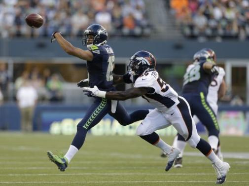 Jackets In The Pros: #59 Danny Trevathan, Denver Broncos, Seattle Seahawks' Jermaine Kearse, left, reaches for a pass just out of reach as Denver Broncos' Danny Trevathan defends in the first half of a preseason NFL football game, Saturday, Aug. 17, 2013, in Seattle. (AP Photo/Elaine Thompson) Photo: AP